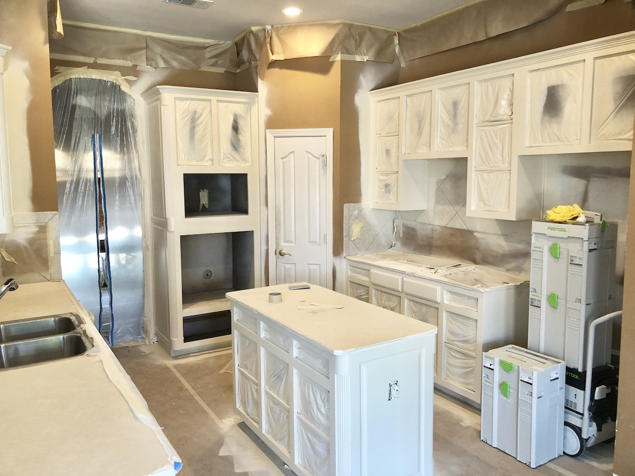 Kitchen Remodel Spraying Cabinets